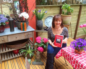Happy author with book